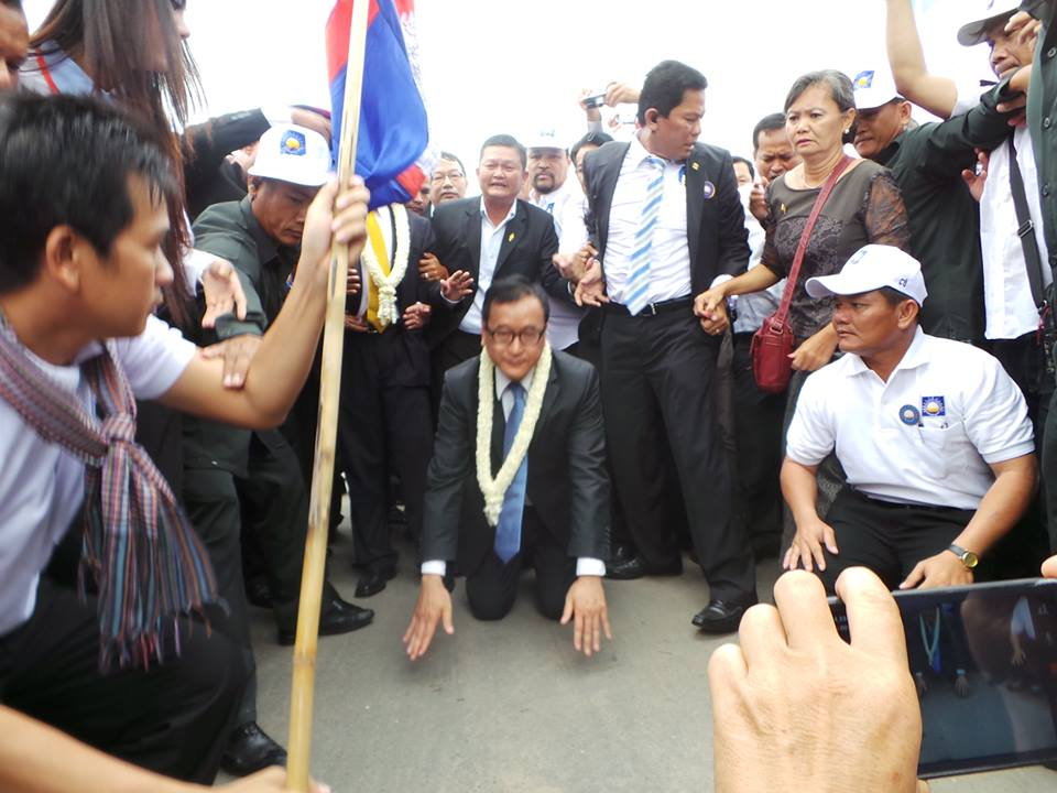 H.E.Sam Rainsy kissed the land